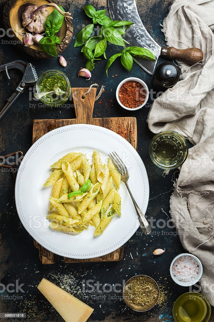 Penne with pesto sauce, parmesan cheese, fresh basil and spices stock photo