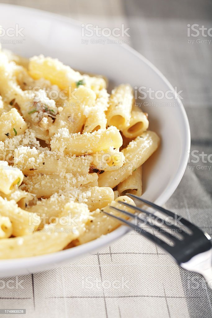 Penne with tomatos and parmesan cheese royalty-free stock photo