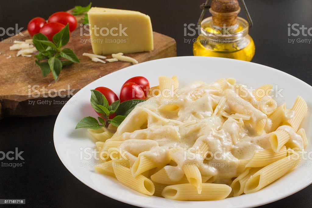 Penne with white sauce stock photo