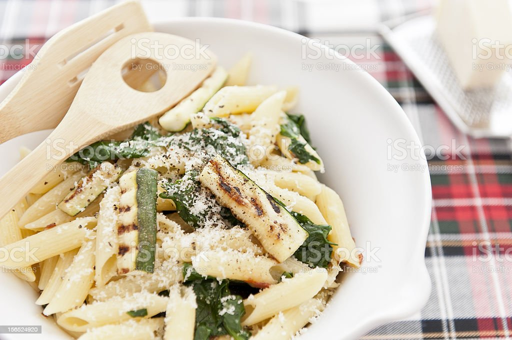 Penne with zucchini and spinach royalty-free stock photo