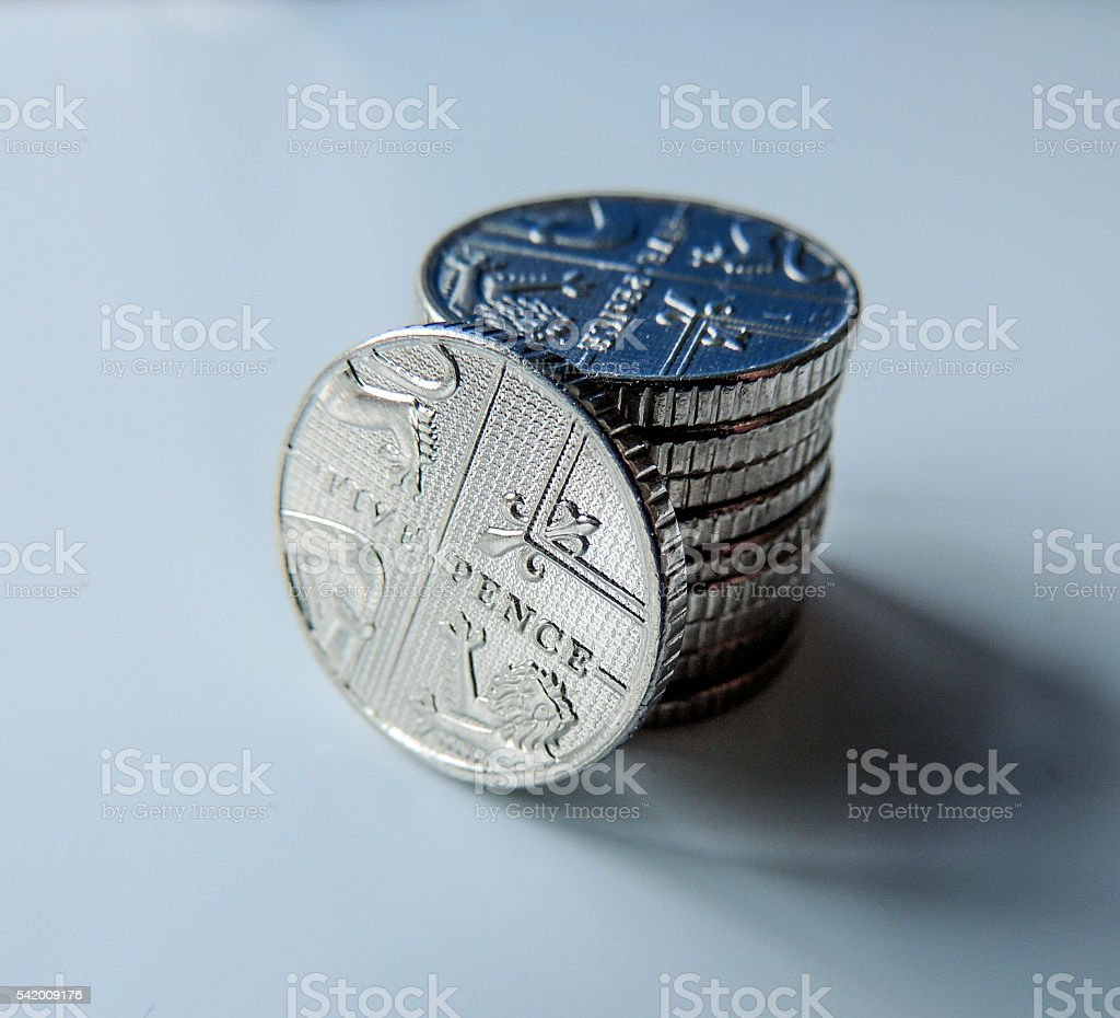 Pennies - five pence coins close up stock photo
