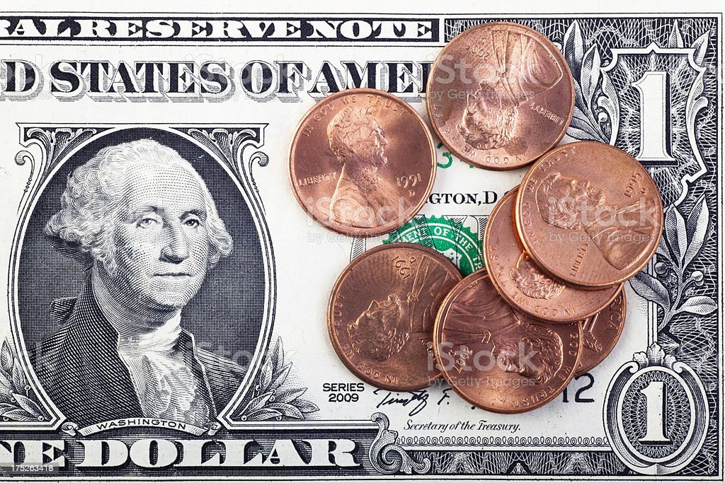 Pennies on a Dollar royalty-free stock photo
