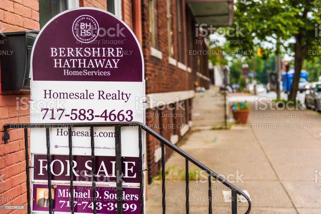 Pennsylvania capital city houses with Berkshire Hathaway for sale sign in downtown by sidewalk street stock photo