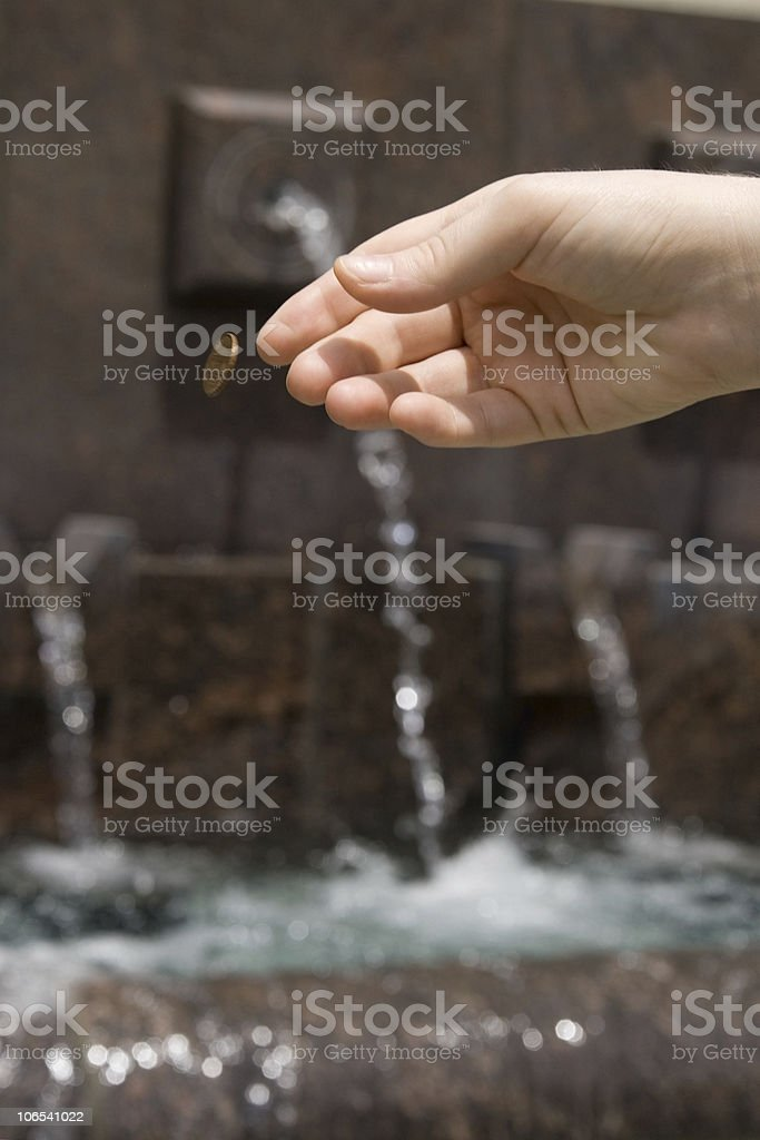 Penny tossed into the fountain for a wish royalty-free stock photo