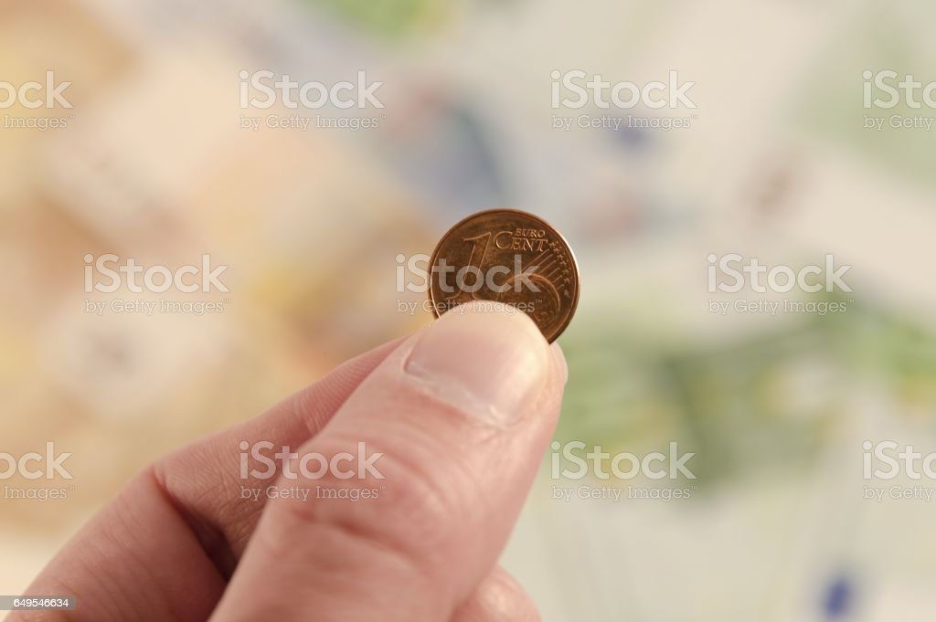 A penny with money in the background stock photo