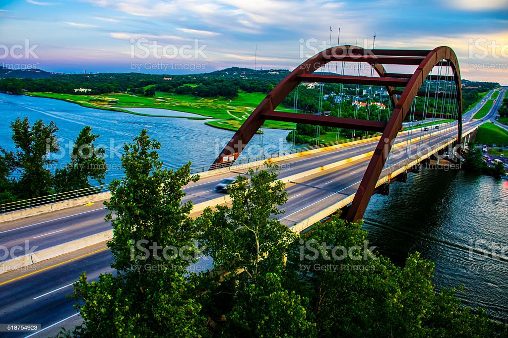 PennyBacker or 360 Bridge shooting clouds and Sharp Trees stock photo
