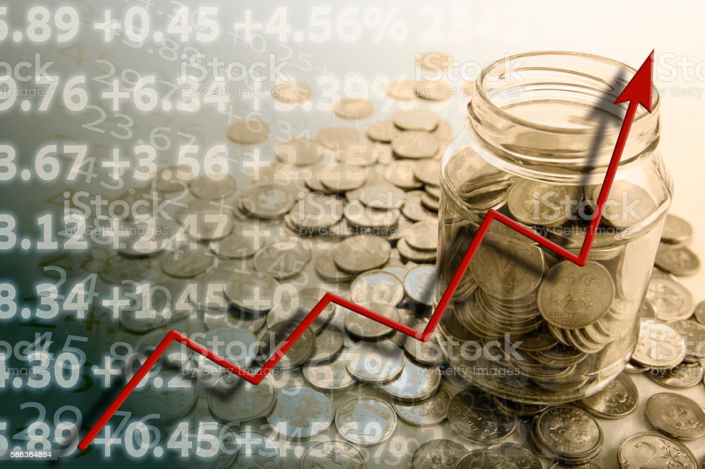 pension with bank of coins stock photo