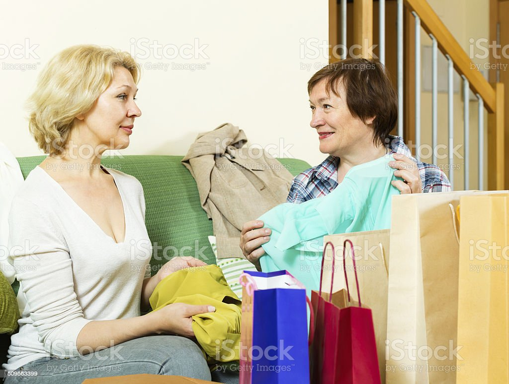 Pensioner bragging with new blouse stock photo