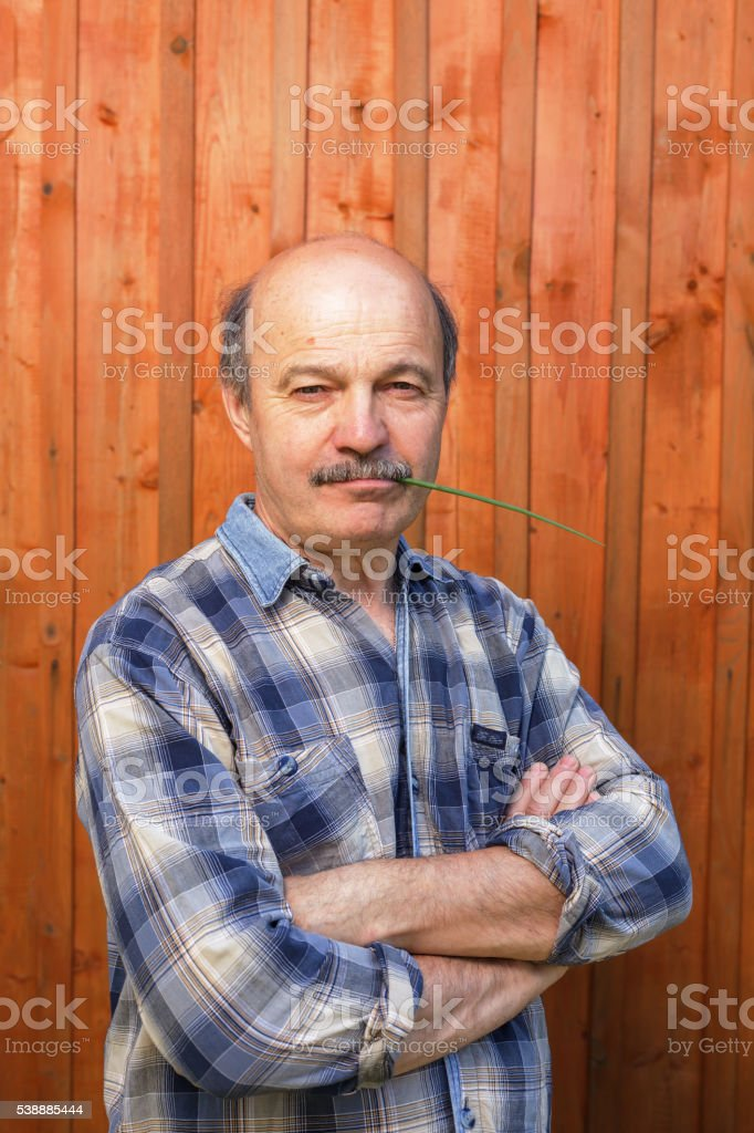 Pensioner complacently looks forward stock photo
