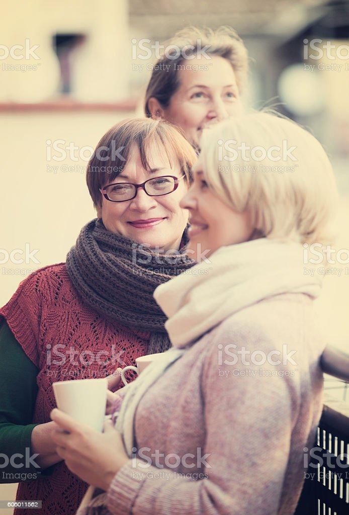 Pensioners having tea on terrace stock photo