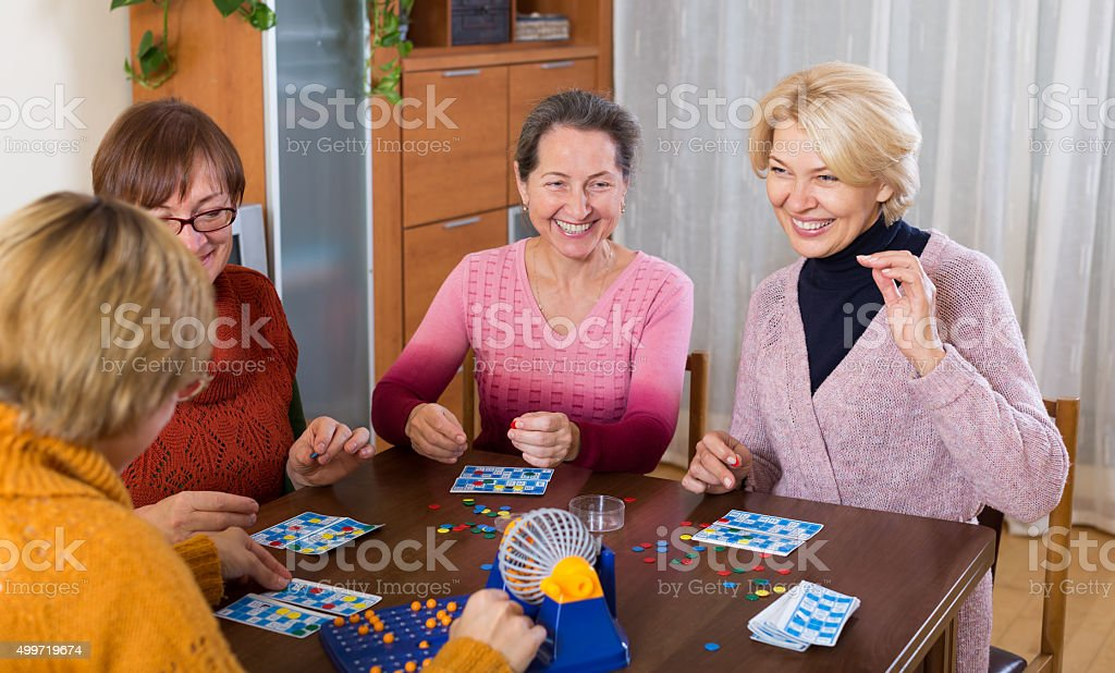 Pensioners playing board game stock photo