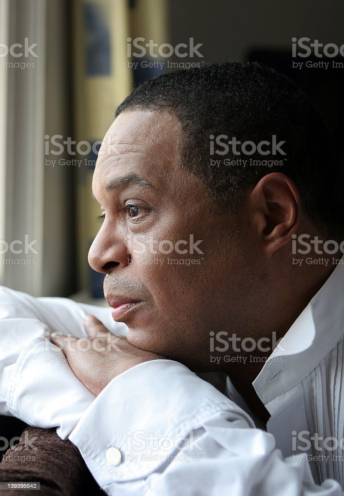 Pensive and thoughtful stock photo