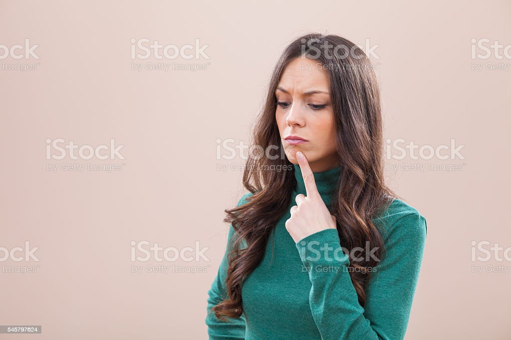 Pensive and worried woman stock photo