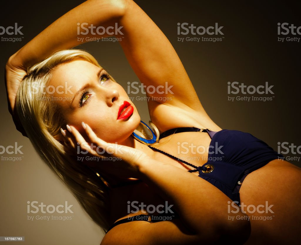 Pensive Blond Woman in Halter Top stock photo