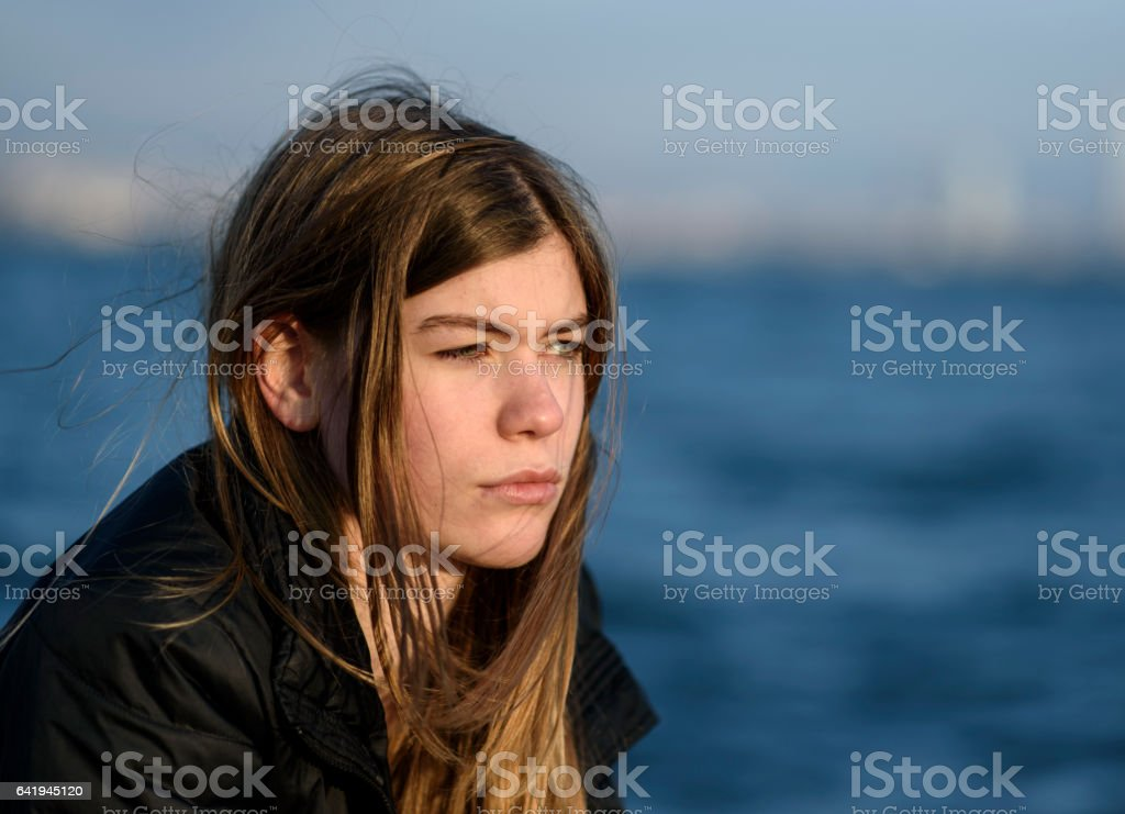 Pensive blond young woman stock photo
