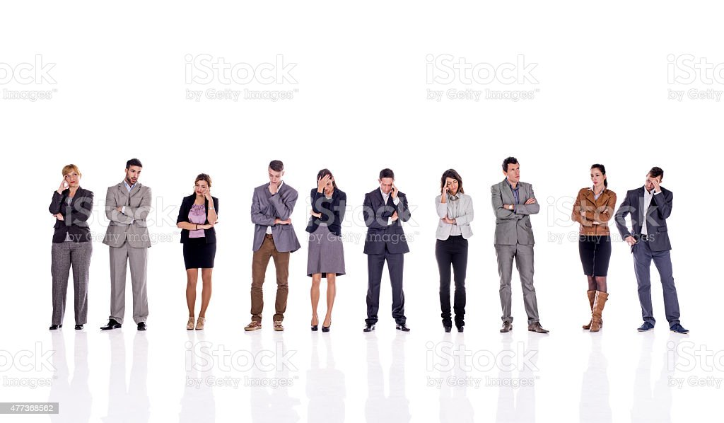 Pensive business people in a line. Isolated on white. stock photo
