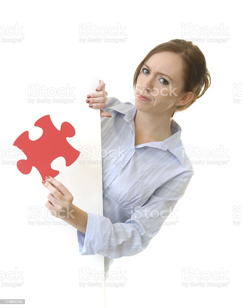 Pensive business woman with puzzle piece royalty-free stock photo