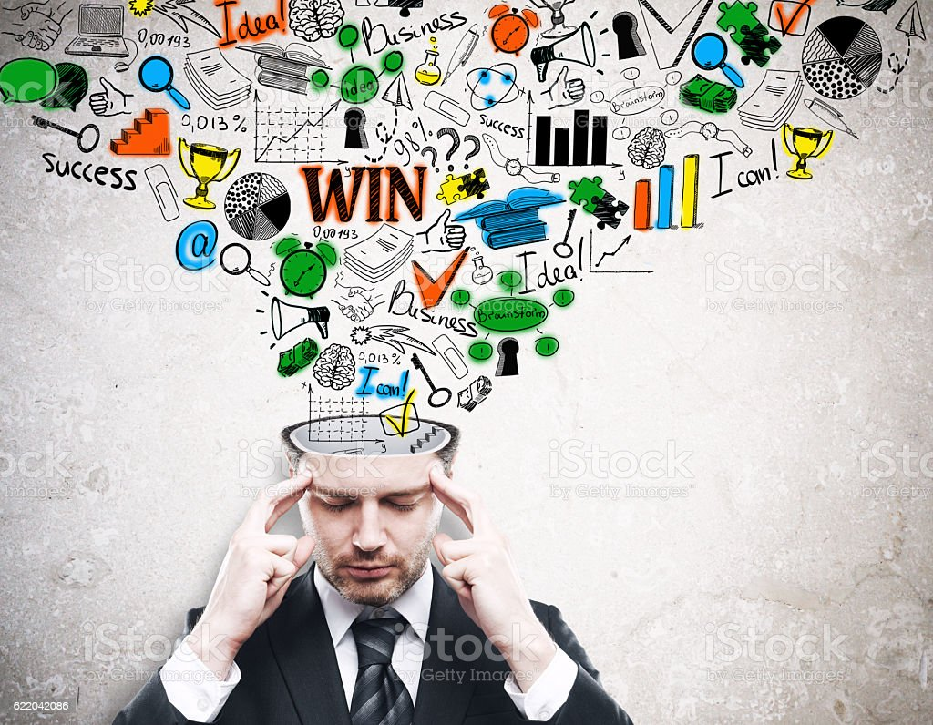 Pensive businessman with business doodle stock photo