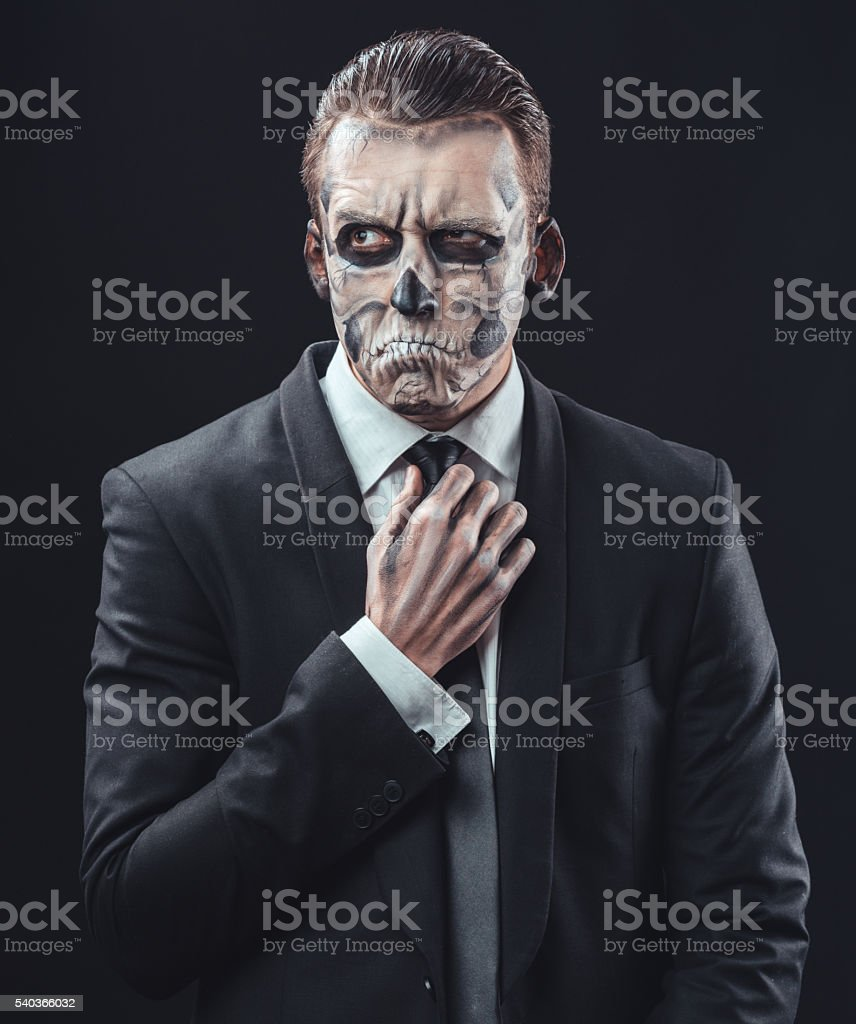 pensive businessman with makeup skeleton stock photo