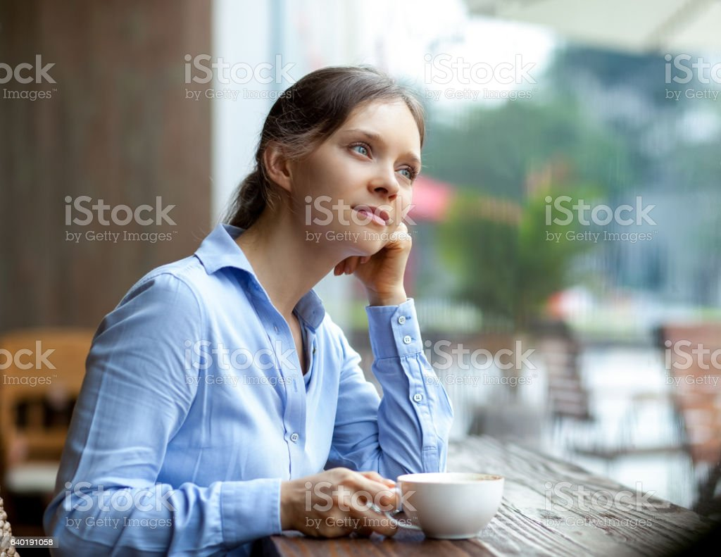 Pensive businesswoman with coffee stock photo