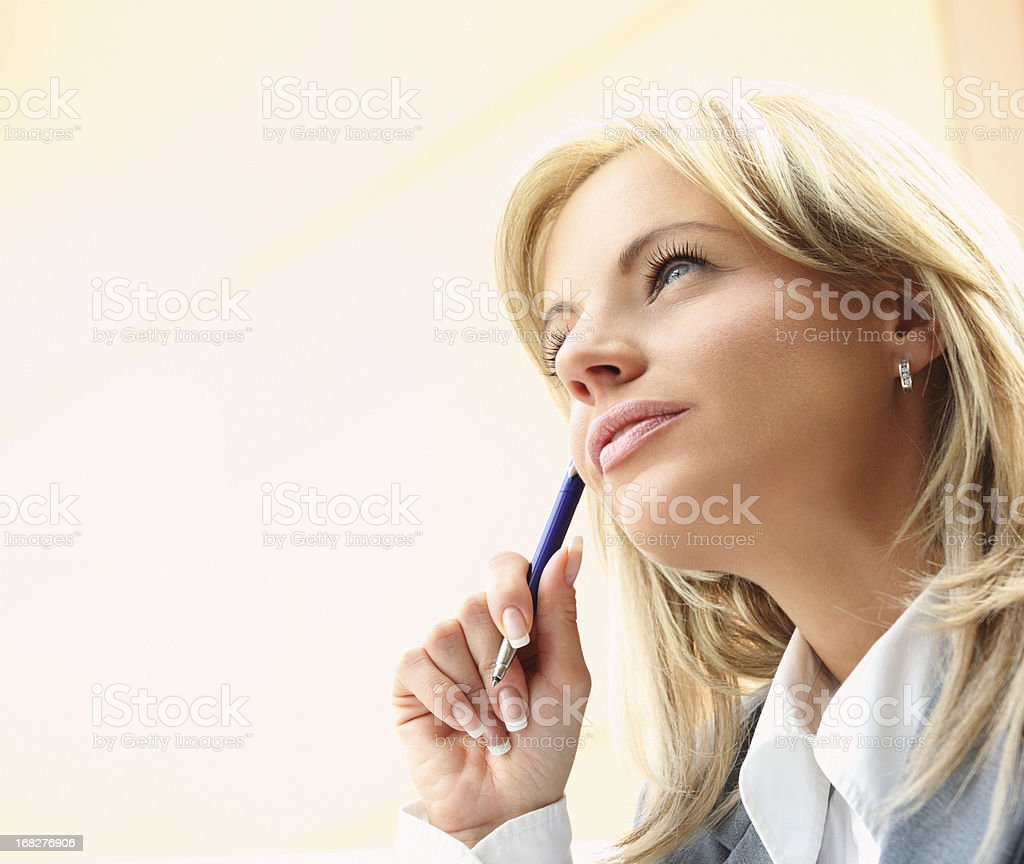 Pensive businesswoman,closeup. stock photo
