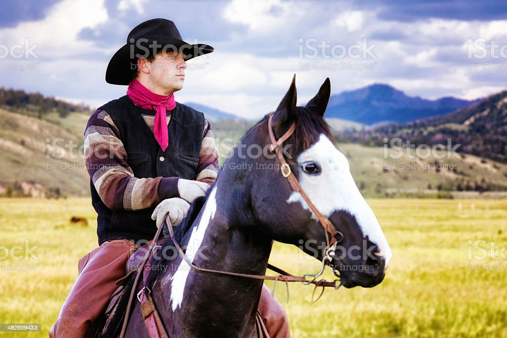 Pensive cowboy horse riding in Montana plains looking right royalty-free stock photo