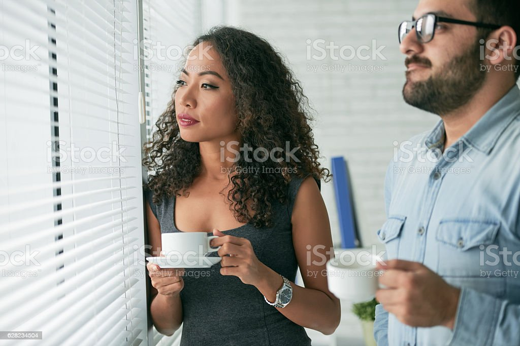 Pensive coworkers stock photo