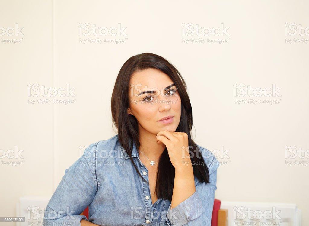 pensive female in her kitchen stock photo