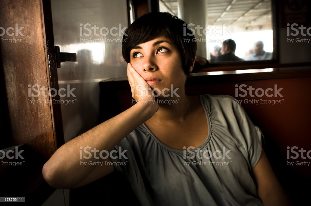 Pensive female in steamboat royalty-free stock photo