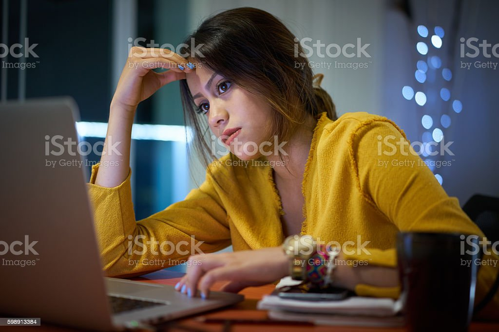 Pensive Girl College Student Studying At Night stock photo