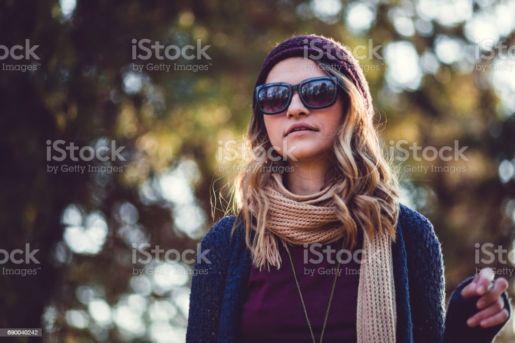Pretty Smoker Girl In Sunglasses On Sunny Day Outdoors