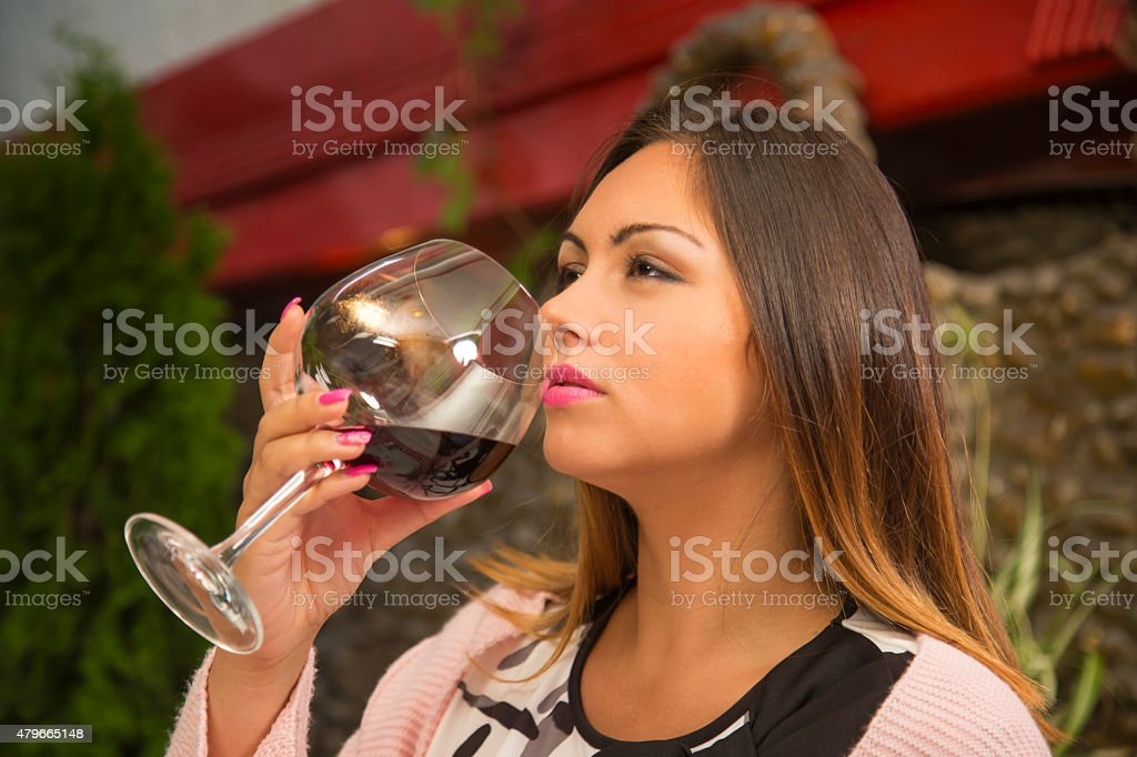 Pensive girl drinking wine. stock photo
