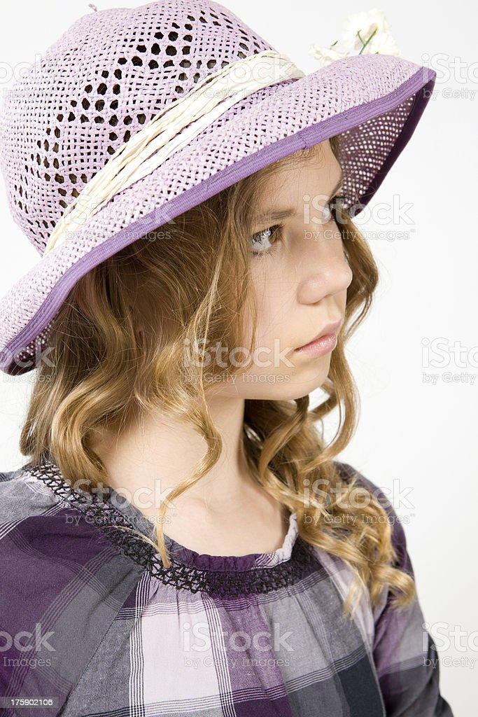 Pensive girl in a hat royalty-free stock photo
