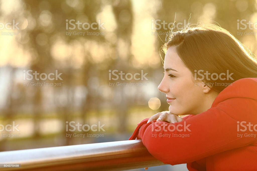 Pensive girl thinking in winter stock photo