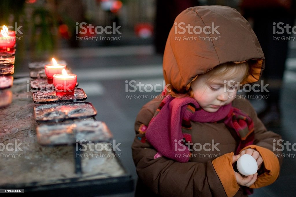 Pensive girl with candle royalty-free stock photo