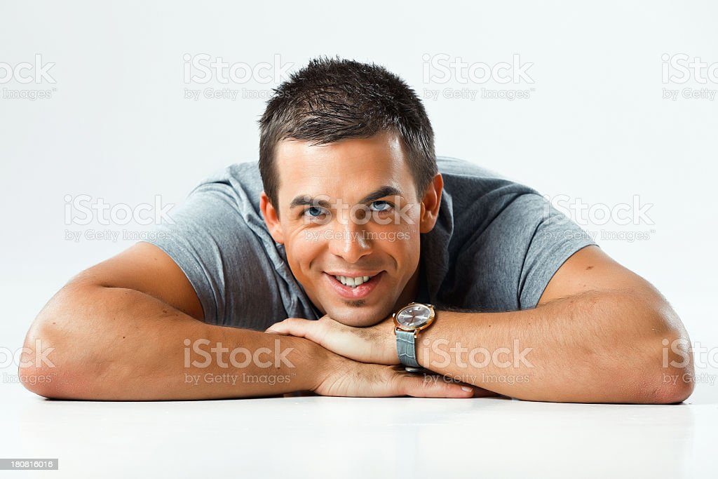 Pensive guy lying on front royalty-free stock photo