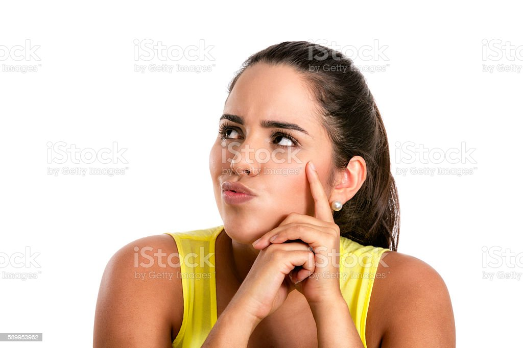 Pensive Hispanic young woman thinking og the options, uncertainty stock photo