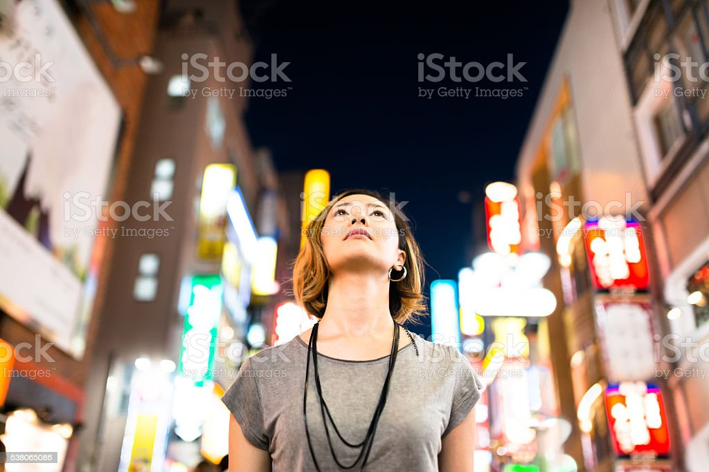 pensive japanese woman enjoy the night in tokyo stock photo
