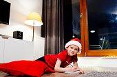 Pensive little boy writing a letter to Santa Claus