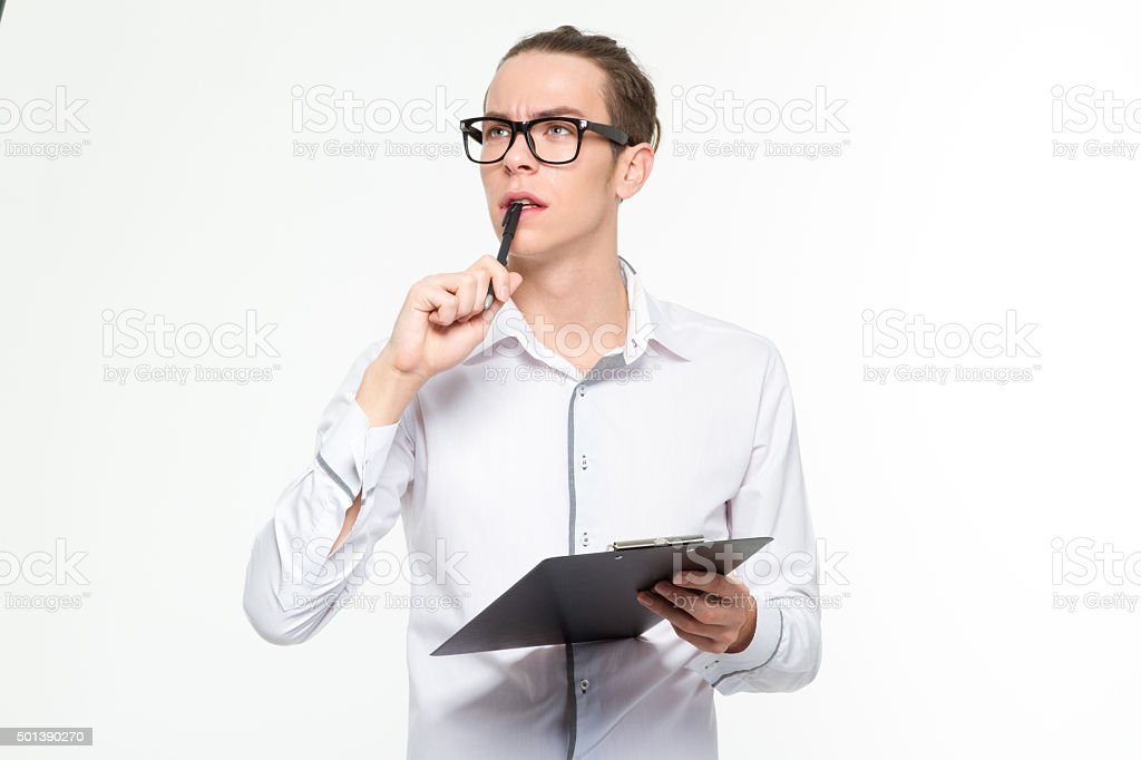 Pensive man holding clipboard stock photo