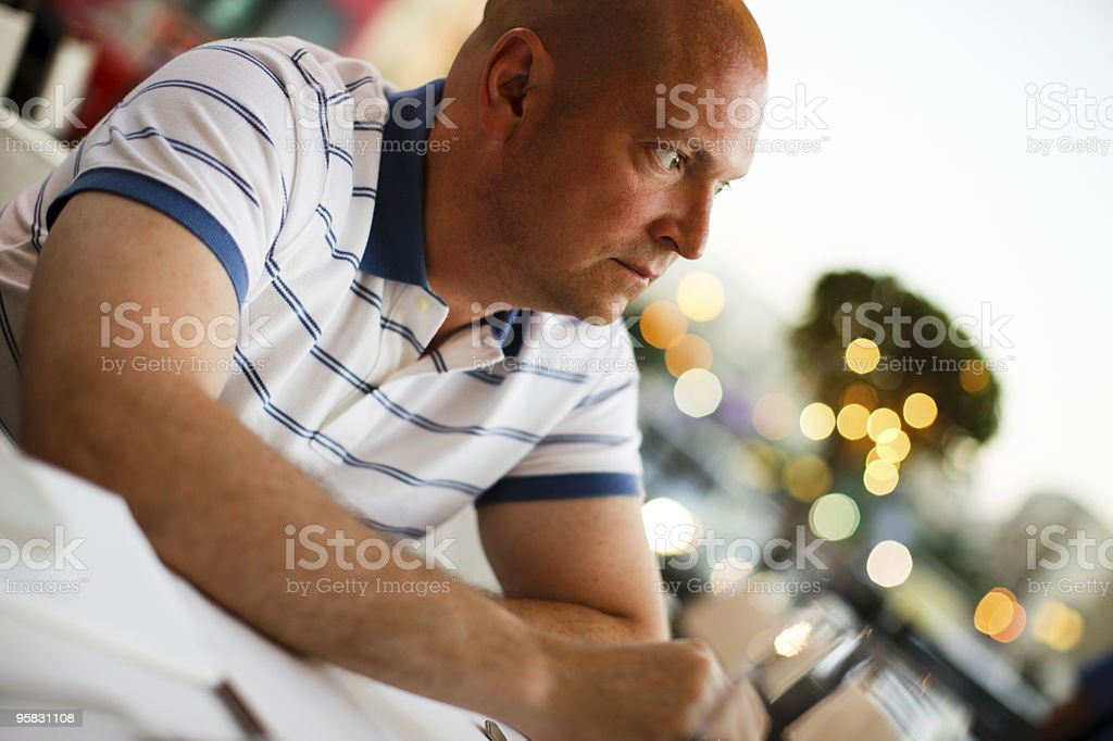 Pensive man in outdoor cafe stock photo