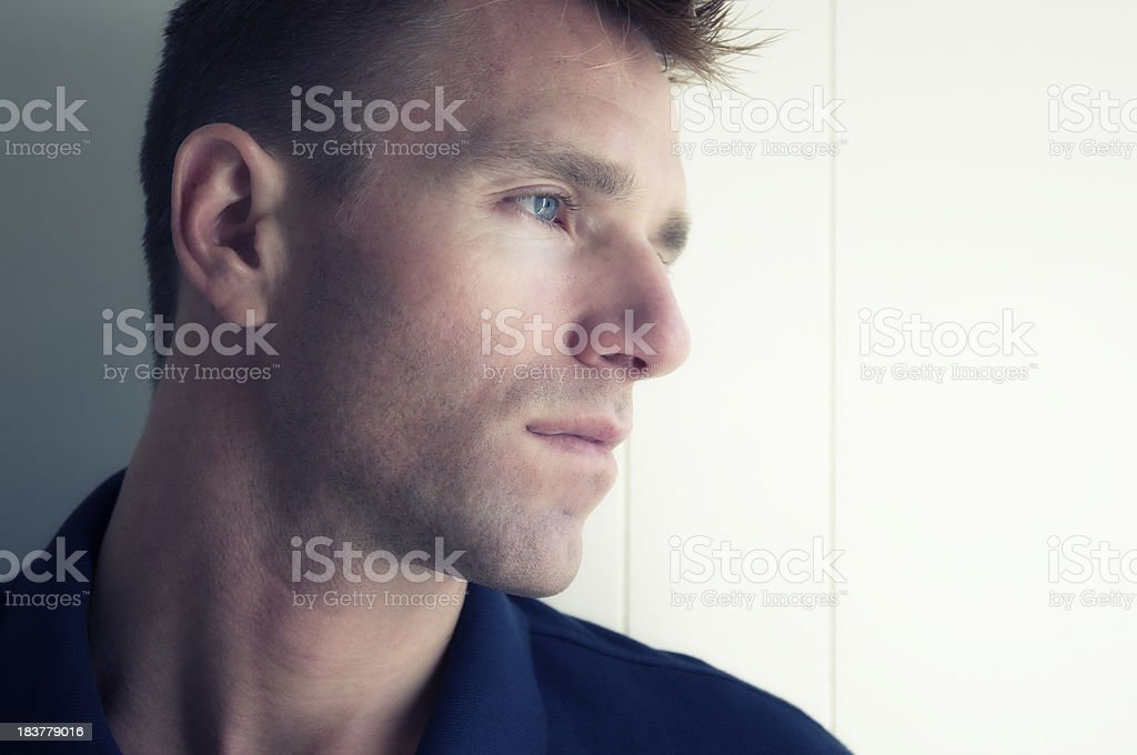 Pensive Man Looks To Side with Serious Expression White Background royalty-free stock photo