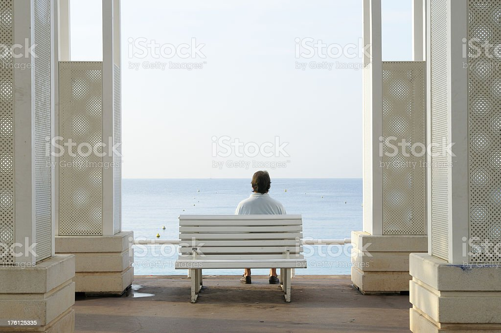 Pensive Man on a Bench Looking the Sea.Copy Space. royalty-free stock photo