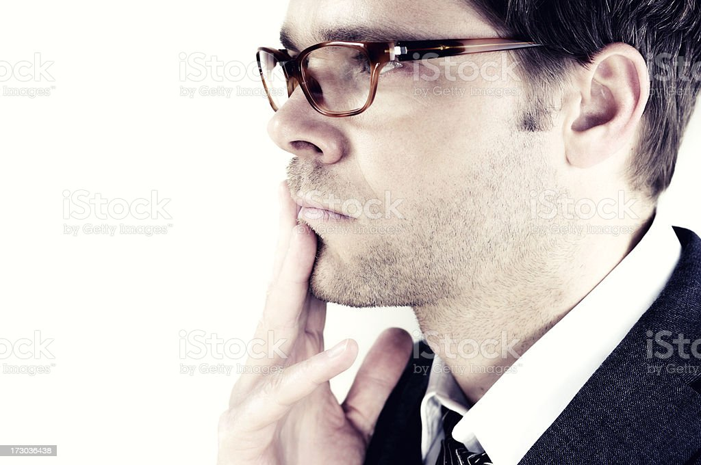 pensive man with horn rimmed glasses royalty-free stock photo