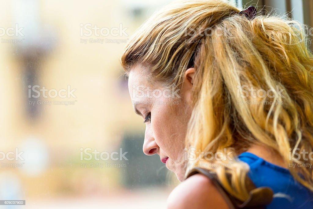 Pensive Mature blond woman stock photo