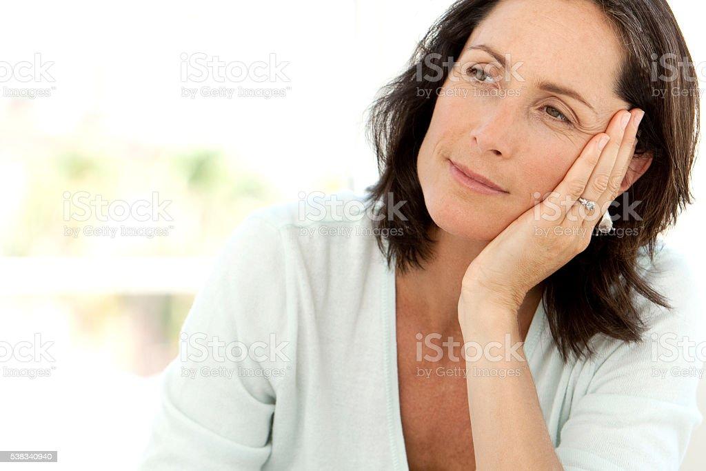 Pensive mature Caucasian woman stock photo