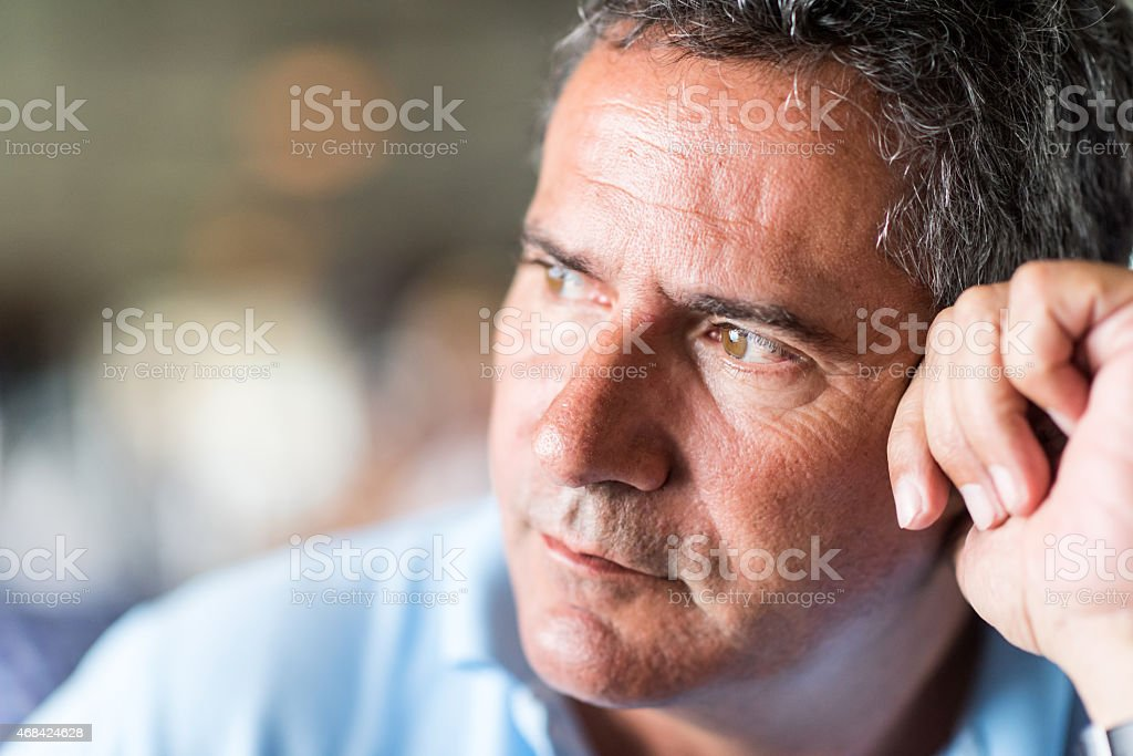 Pensive mature man stock photo