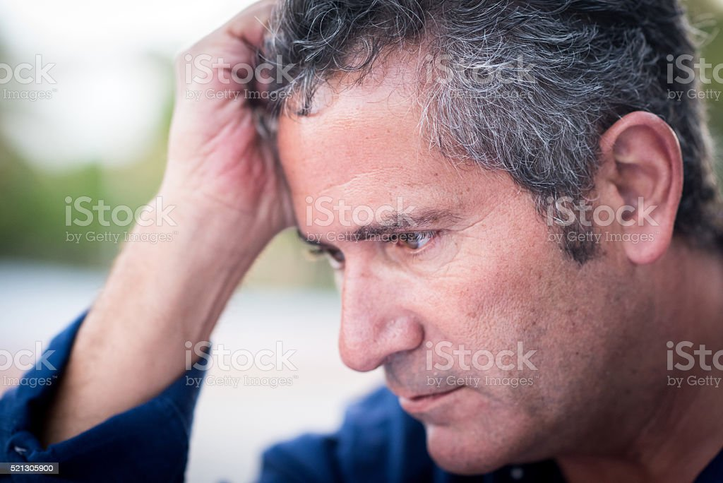 Pensive mature man stock photo