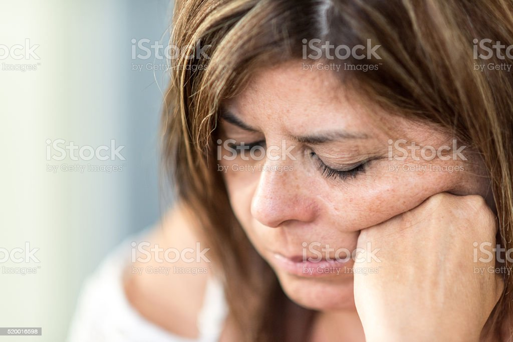 Pensive Mature woman stock photo