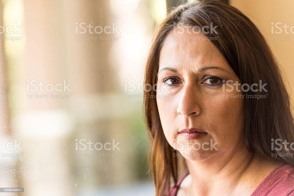 Pensive Mature woman stock photo